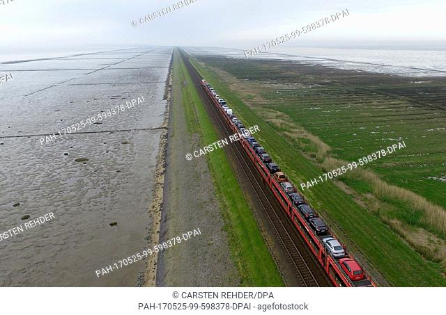 A Deutsche Bahn car-carrying train travelling along the Hindenburgdamm between Sylt and Niebuell, Germany, 17 May 2017. The dam turns 90 years old on 01 June...