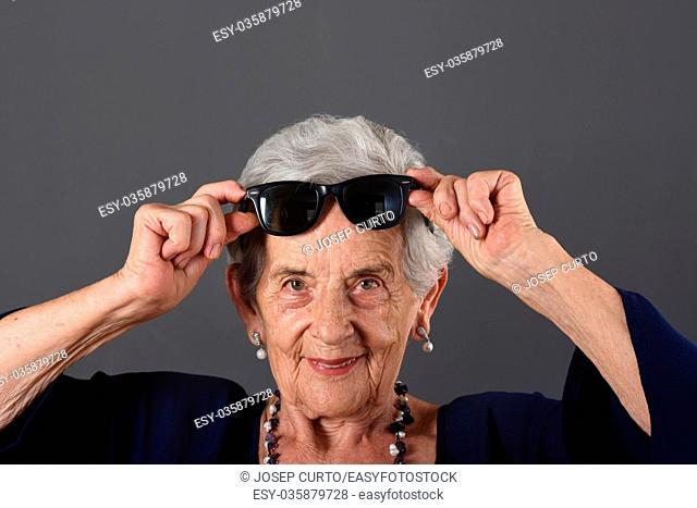 Portrait of a senior woman with sunglasses on forehead