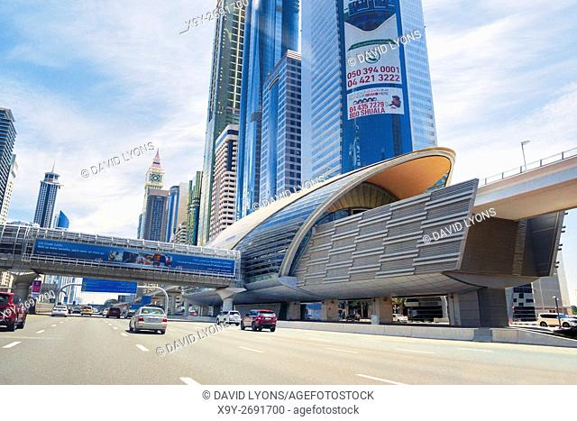 City of Dubai. Financial Centre Metro Station on Sheikh Zayed Road. Al Yaquob Tower in distance. United Arab Emirates