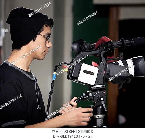 Hispanic student operating video camera