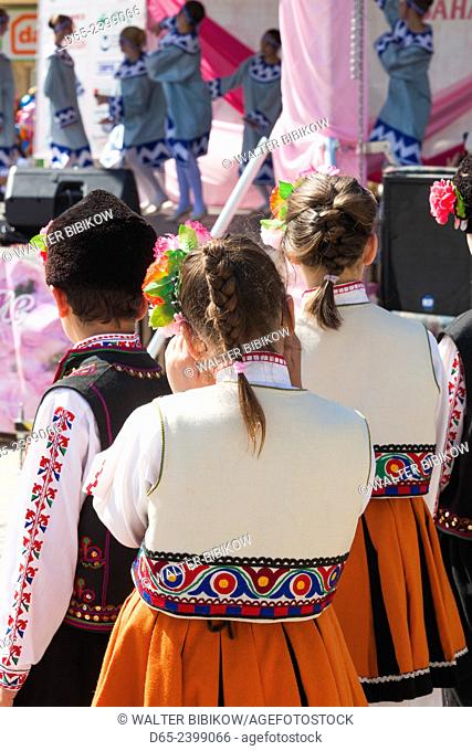 Bulgaria, Central Mountains, Kazanlak, Kazanlak Rose Festival, town produces 60% of the world's rose oil, young girl dancer in traditional costume, NR