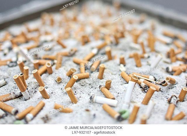 Cigarette butts in sand box