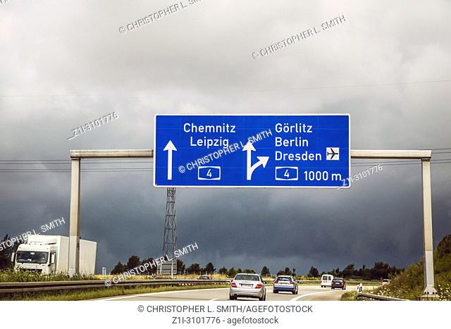 Blue overhead autobahn sign pointing to a intersection towards Leipzig and Berlin in Germany