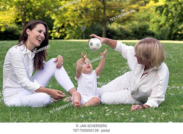 Three generation family playing in park