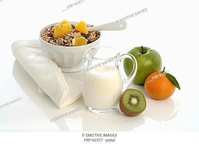 Muesli with apple, kiwi and tangerine