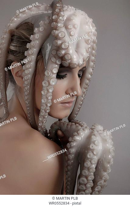 young woman with octopus on head