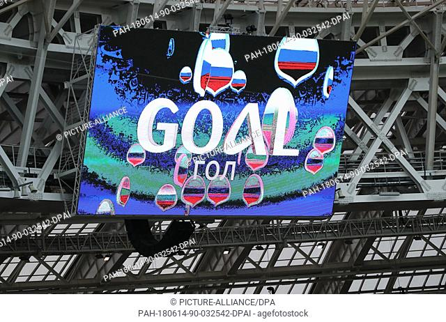 14 June 2018, Russia, Moscow, Soccer; FIFA World Cup, First Round, Group A, First Matchday, Russia vs. Saudi Arabia at the Luzhniki Stadium: The word 'goal' is...