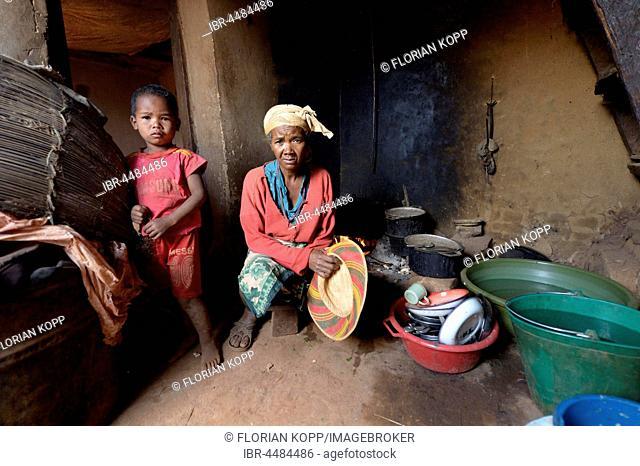 Woman and boy in kitchen, Analakely village, Tanambao commune, Tsiroanomandidy district, Bongolava region, Madagascar