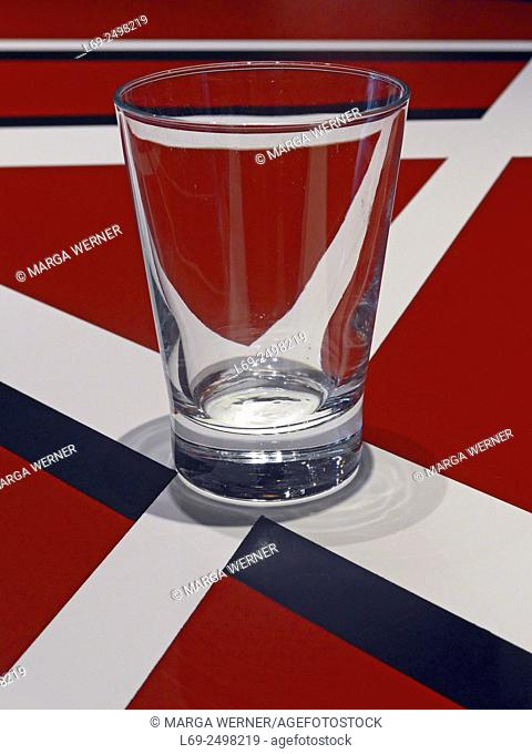Empty glass on a decorated table