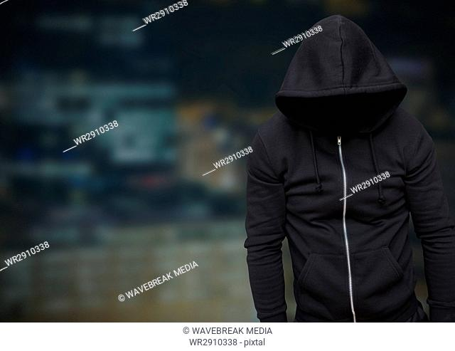 Anonymous Criminal Man in hood in front of night city