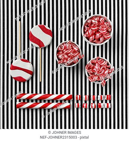 Stripy sweets on stripy background