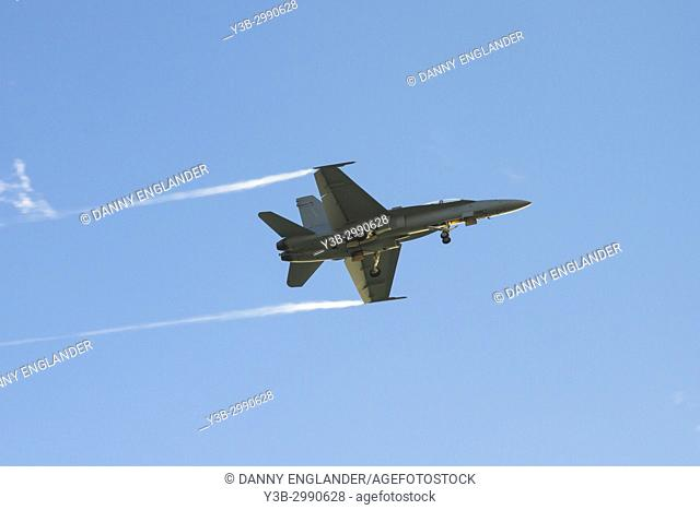 An F/A-18 Super Hornet jet airplane coming in for a landing at North Island Naval Base in San Diego, California