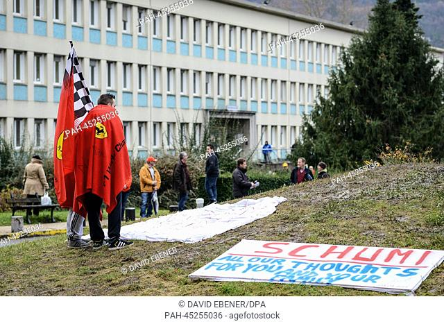 On the day of Michael Schumacher's 45th birthday, fans stand in front of 'Centre Hospitalier Universitaire' (CHU) hospital in Grenoble, near the French Alps