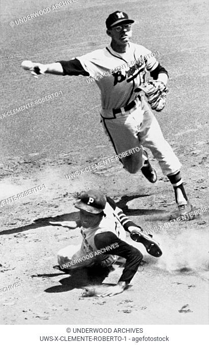 Milwaukee, Wisconsin: July 8, 1961.Pittsburgh Pirates outfielder Roberto Clemente is forced out at second base as Braves shortstop Roy McMillan relays the throw...