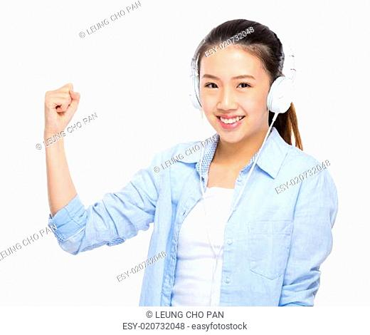 Asian young woman listen to music with headphone and arm clench