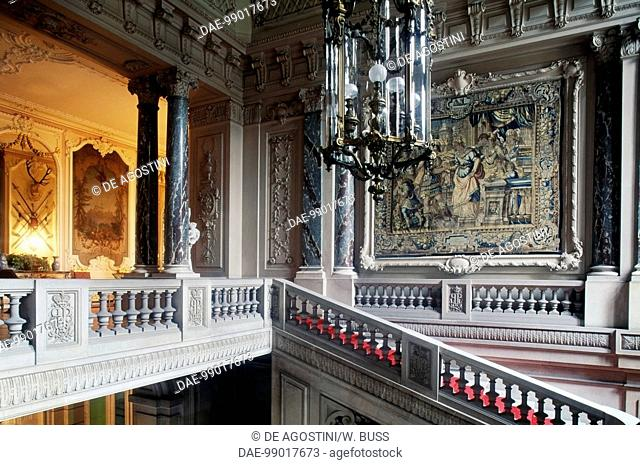 Staircase with chandelier and tapestry, Pszczyna castle, Silesian voivodship. Poland, 13th-19th century