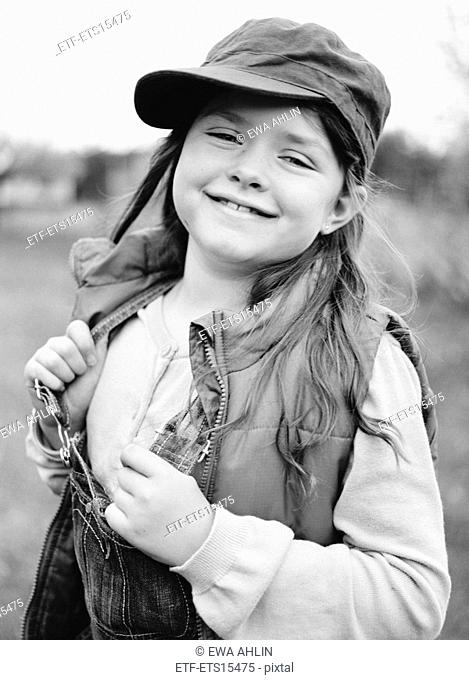 Portrait of a girl with a cap and dungarees Sweden