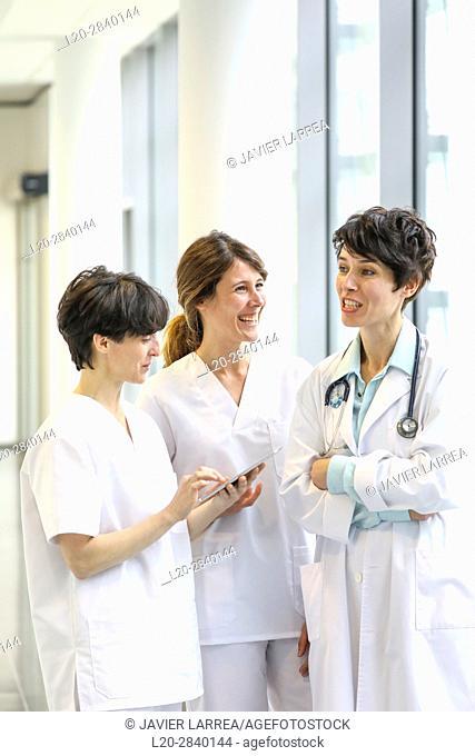 Doctors and nurses talking in corridor, Hospital
