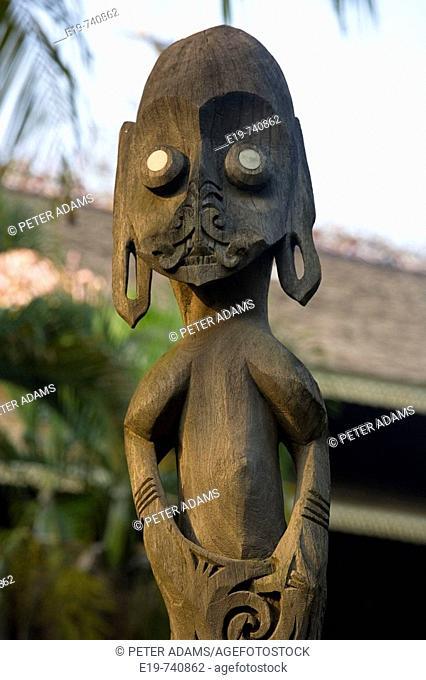 East Kalimantan statue outside house, Taman Mini Indonesia, Jakarta, Indonesia. East Kalimantan statue outside traditional house