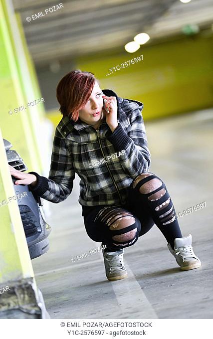 Teen girl is wondering talking on cellphone