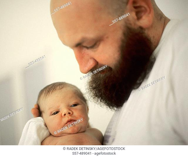 Father and new born baby in maternity hospital