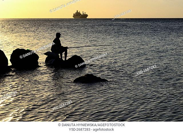 Africa, Mauritius, sunset at the coast of Indian Ocean near Port Louis, Tombeau Bay