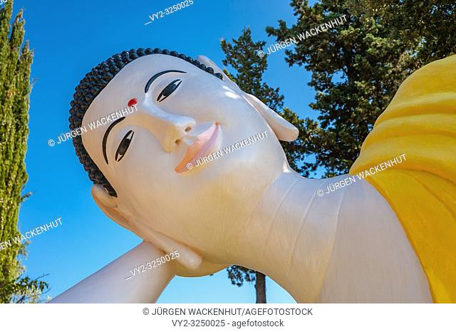 Reclining Buddha in the park of pagoda Hong Hien, Frejus, Var, Provence-Alpes-Cote d`Azur, France, Europe