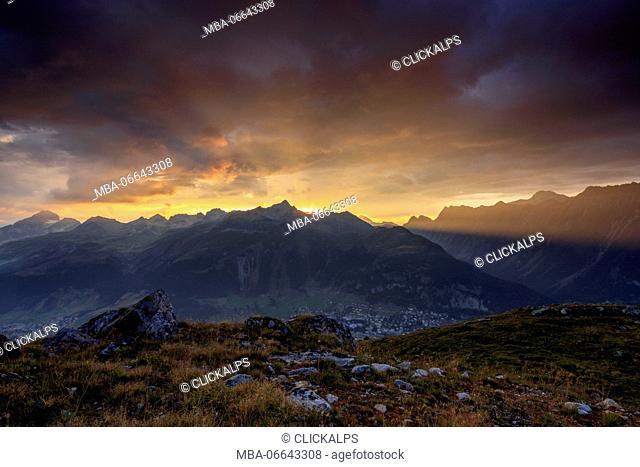 Fiery sky and dark clouds on high peaks of Muottas Muragl at sunset St.Moritz Engadine Canton of Graubünden Switzerland Europe
