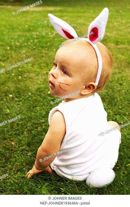Baby wearing rabbit costume, Djurgarden, Sweden