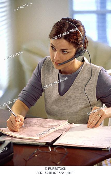 Businesswoman talking on a headset