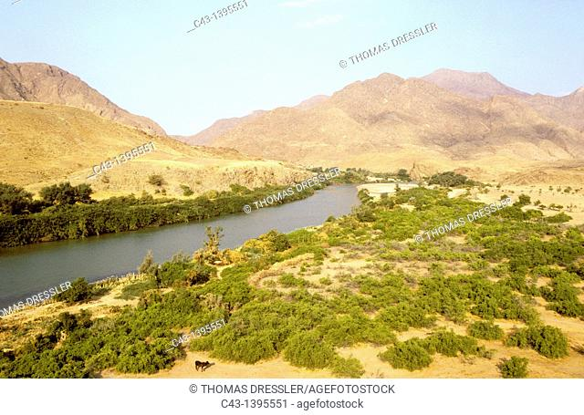 Namibia - Kunene River, border river between Namibia and Angola, at the Marienfluss Valley in the Kaokoveld