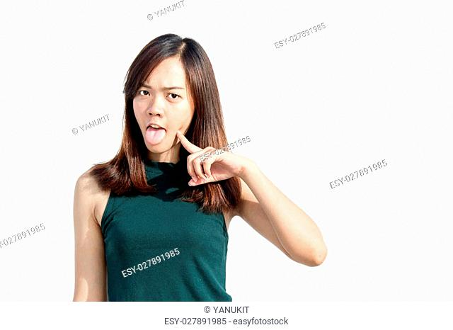 close up asian tahi girl action funny face with finger on white