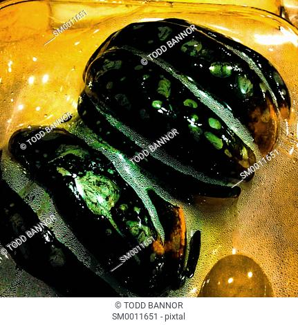Plastic wrap shrinking onto acorn squash after removal from microwave oven