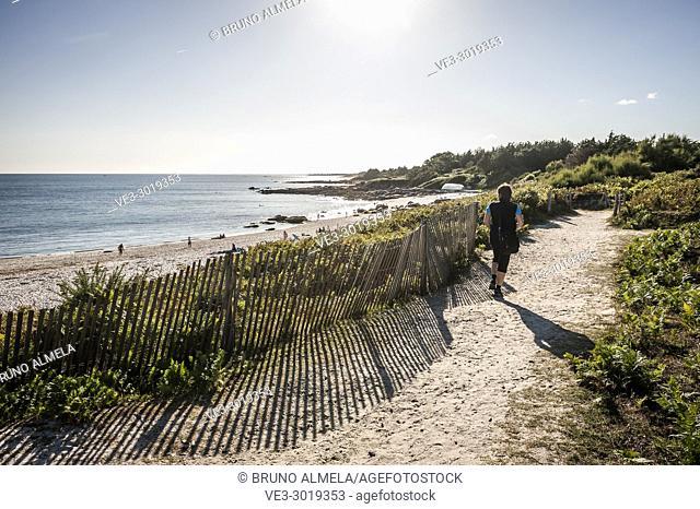 Walking in Beg Meil beach in Fouesnant (department of Finistère, region of Bretagne, France)