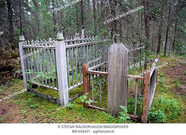 Old native burial ground, wooden gravestones, near Hootalinqua, Yukon Territory, Canada