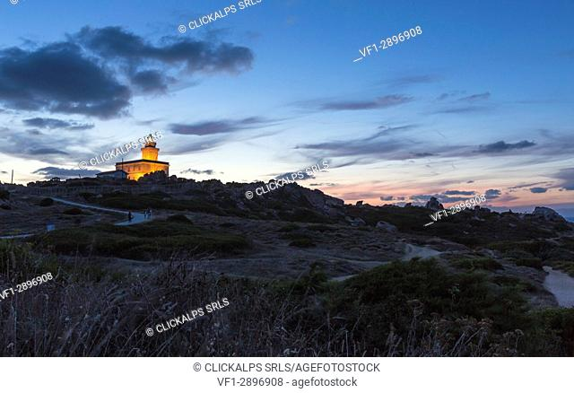 Lights of dusk on the lighthouse surrounded by rock Capo Testa Santa Teresa di Gallura Province of Sassari Sardinia Italy Europe