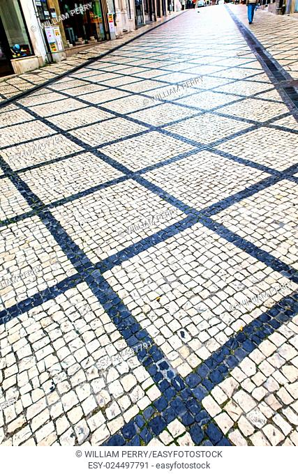 Black White Tiles, Portuguese Symbol, Medieval City Coimbra Portugal. All streets in Portugguese cities and former Portuguese colonies, such as Brazil and Macao