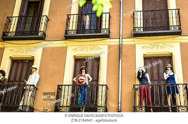 View of five models in a building of a central street of Madrid city, Spain