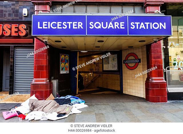 England, London, Soho, Rough Sleeper at Subway Entrance