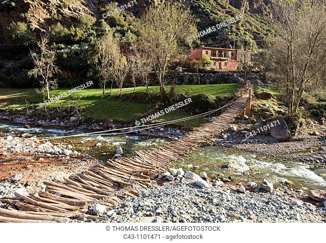 Morocco - A plank bridge often is the only access to the houses in the Ourika Valley, a prelude to the High Atlas mountains and a popular weekend escape for...