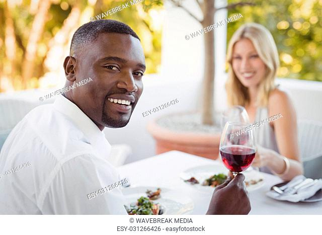 Couple toasting their wine glasses