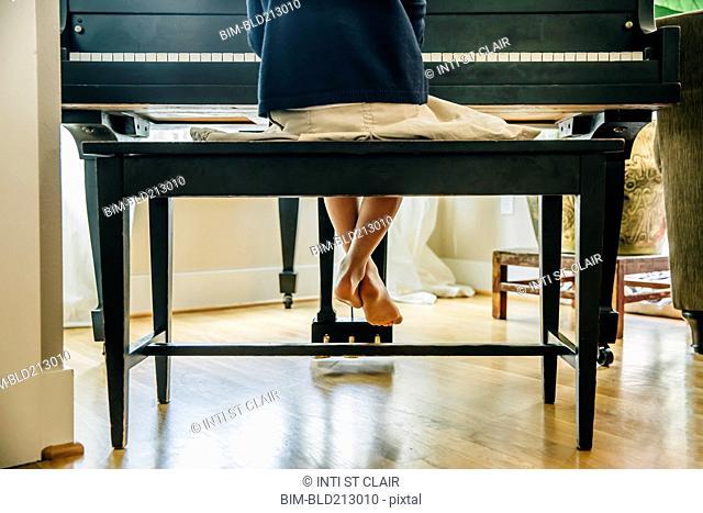 Mixed race girl playing piano