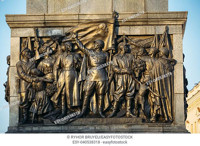 MINSK, BELARUS - MARCH 10, 2015: Bas-relief Scenes On The Wall Of The Stele Dedicated To The Memory Of The Great Patriotic War