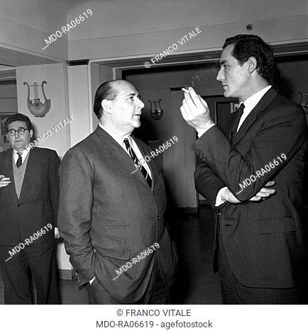 Italian director Roberto Rossellini and Italian actor Vittorio Gassman chatting at a convention. 1956