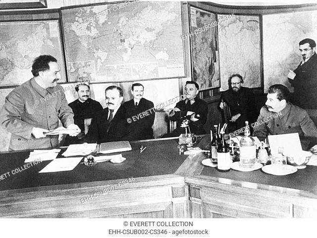 Josef Stalin (seated, right) is shown a 13.787 kilogram gold nugget by G.K. Orjonikioze. Jan 29, 1936, Moscow. The nugget was found at the Uralzoloto fields