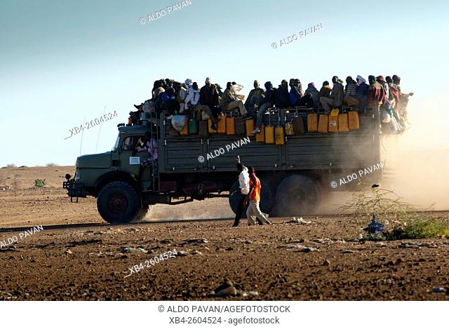 Niger, Agadez, truck of emigrants leaving the town and crossing the desert