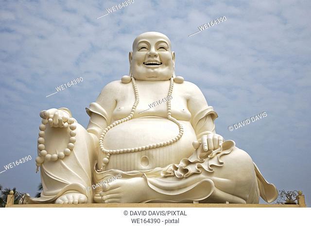 Sitting Buddha statue at the Vinh Trang Temple in Mytho City, Mekong Delta, Vietnam