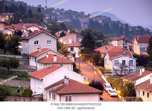 France, Haute-Loire Department, Auvergne Region, Le Puy-en-Velay, hillside houses, dusk