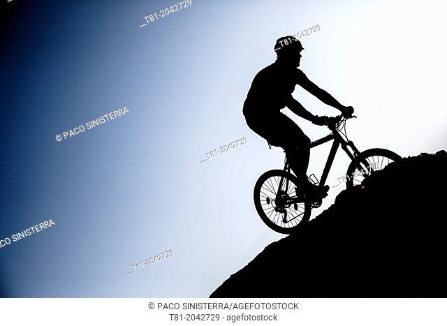 Silhouette biking btt decline in the Sierra de Cazorla, Andalucia, Spain