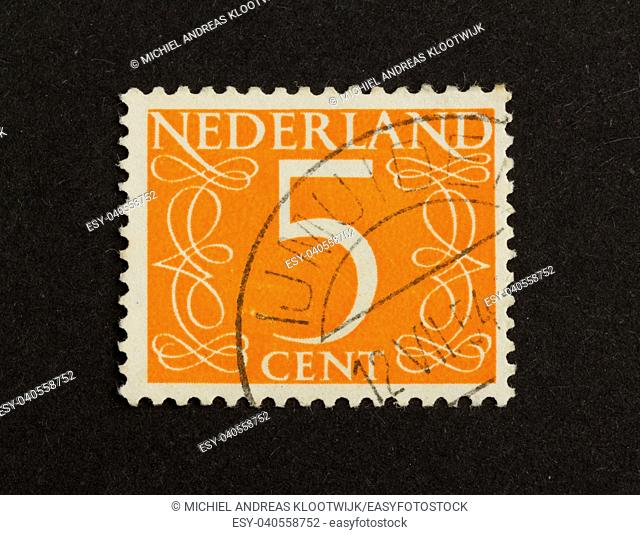 THE NETHERLANDS - CIRCA 1950: Stamp printed in the Netherlands shows the number 5, circa 1950